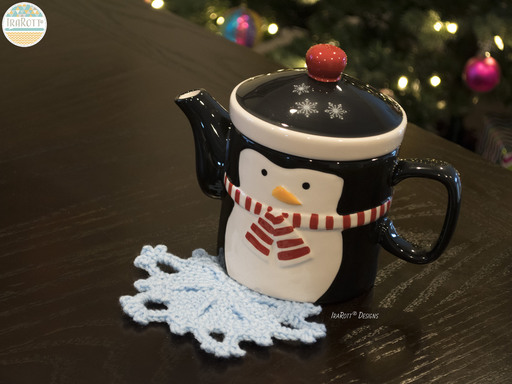 Free PDF Crochet Pattern for making a beautiful Festive Snowflake Coaster or Window Decoration.